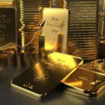 Vor einem Hintergrund gestapelter Goldbarren liegen im Vordergrund weitere Goldbarren.
