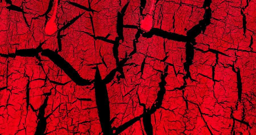 Zerklüftete, rissige Oberfläche in alarmierendem Rotton